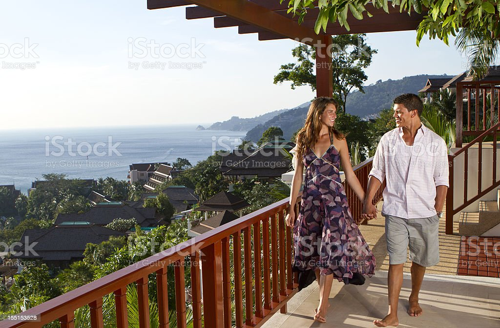 Holding hands in a hallway near the sea royalty-free stock photo