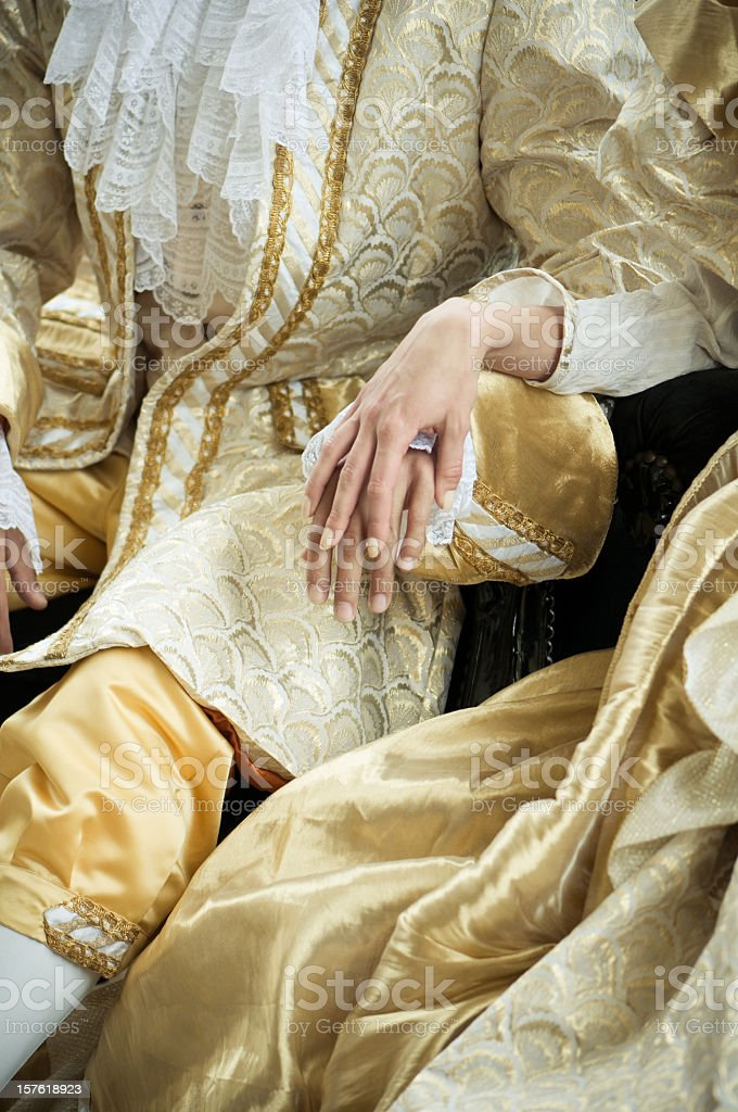 Holding Hands in Ancient Costumes stock photo