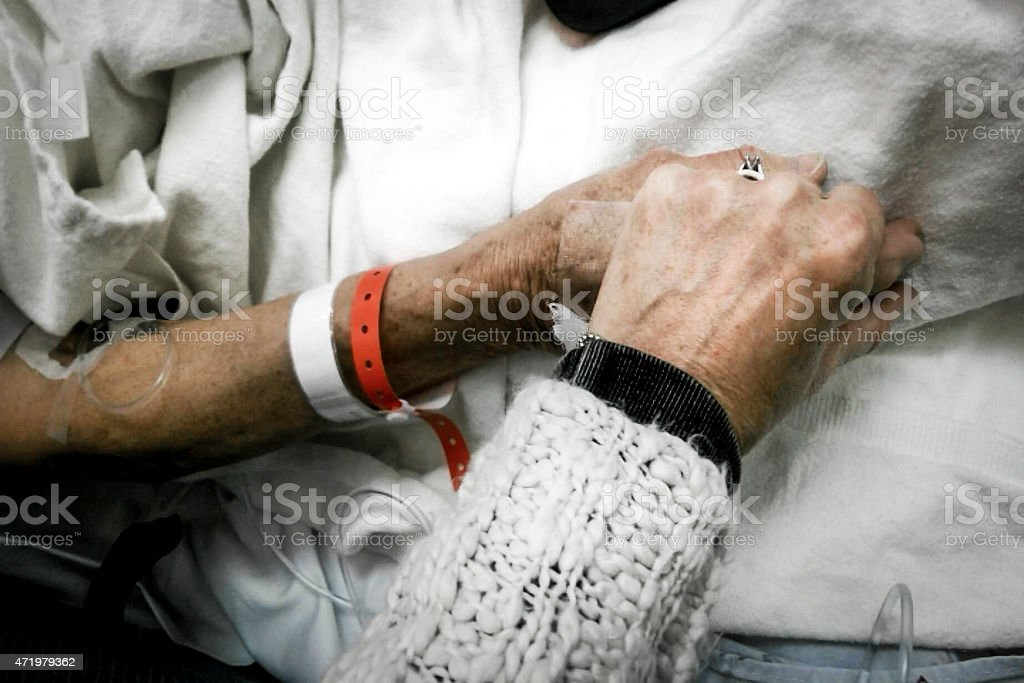 Holding hands in hospital stock photo