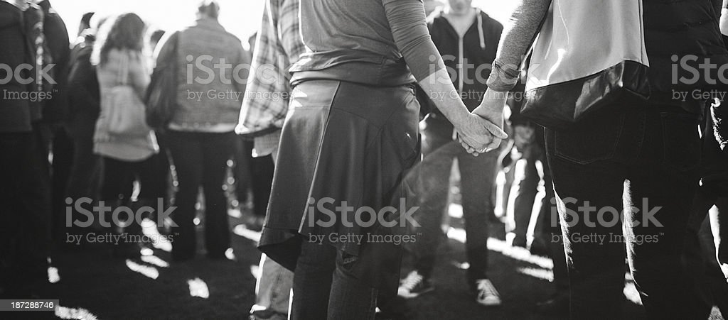 Holding Hands in Unity and Prayer stock photo