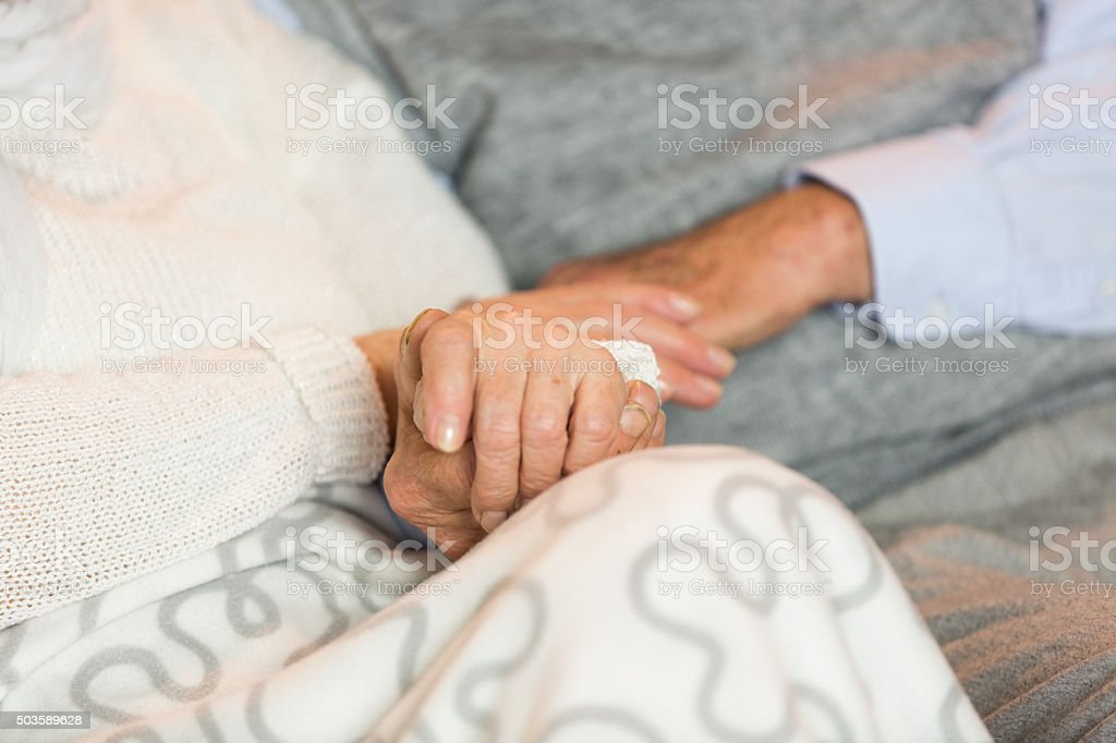 Holding hands stock photo