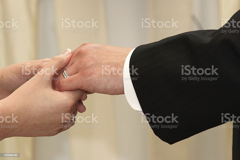 Holding hands, woman and man royalty-free stock photo