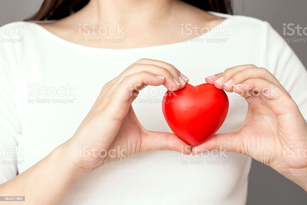 Holding Heart stock photo