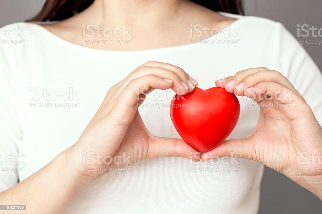 Holding Heart stock photo