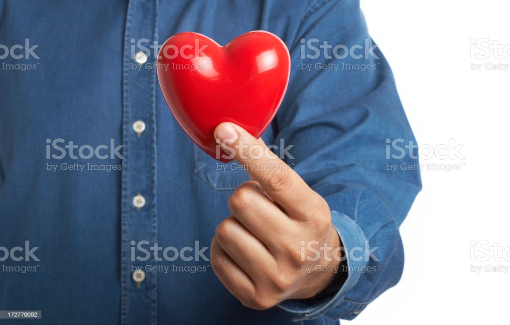 holding heart up to chest stock photo