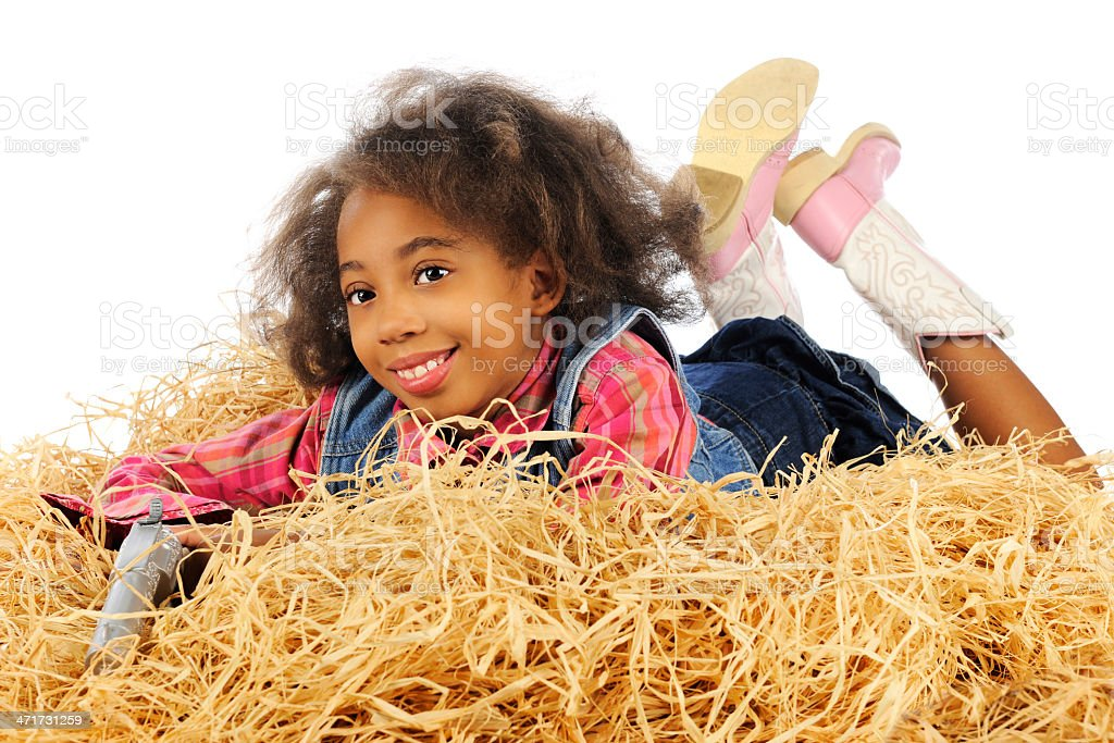 Holding Her Gun in the Hay royalty-free stock photo