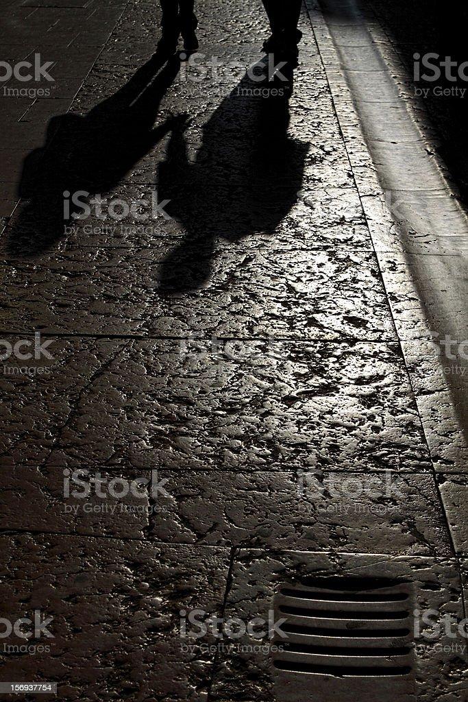 Holding her hand in Verona stock photo