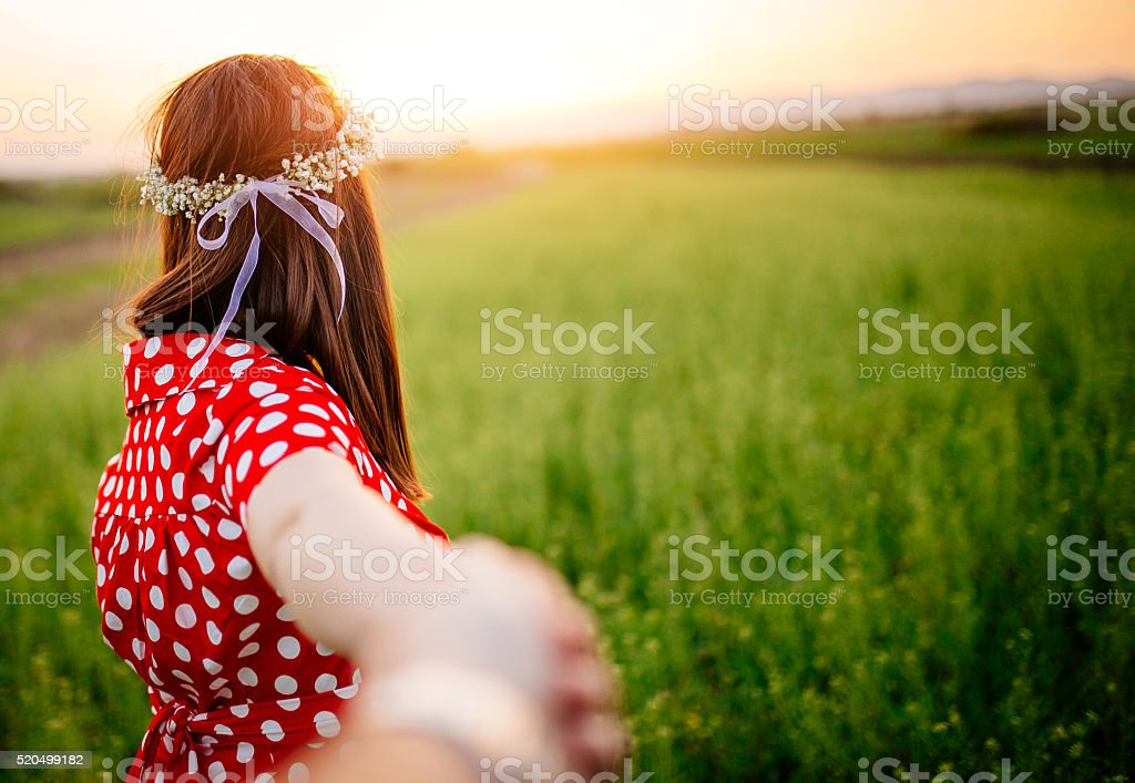 Holding her hand on a filed stock photo