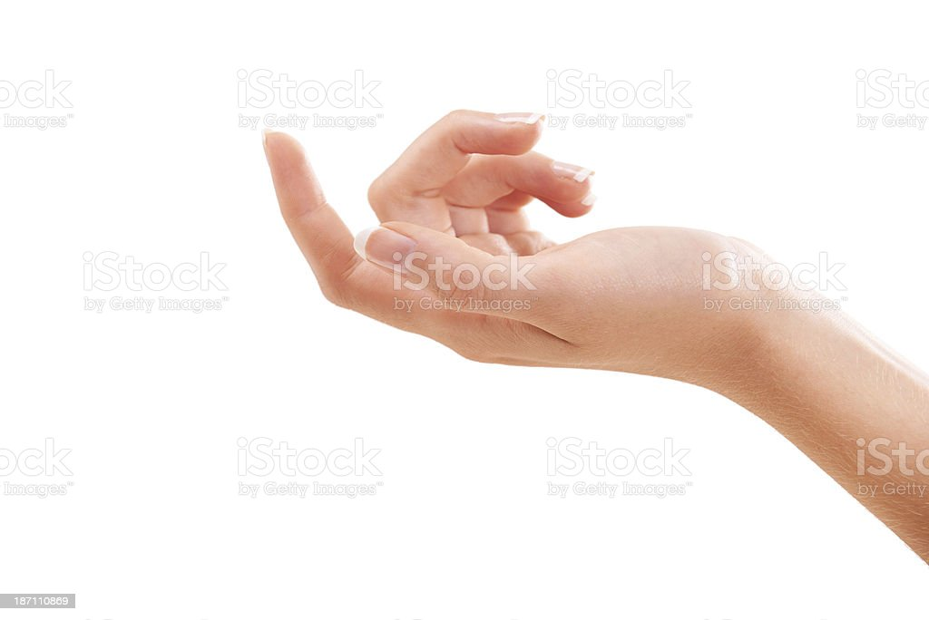 Holding her hand out for fresh skin treatment royalty-free stock photo