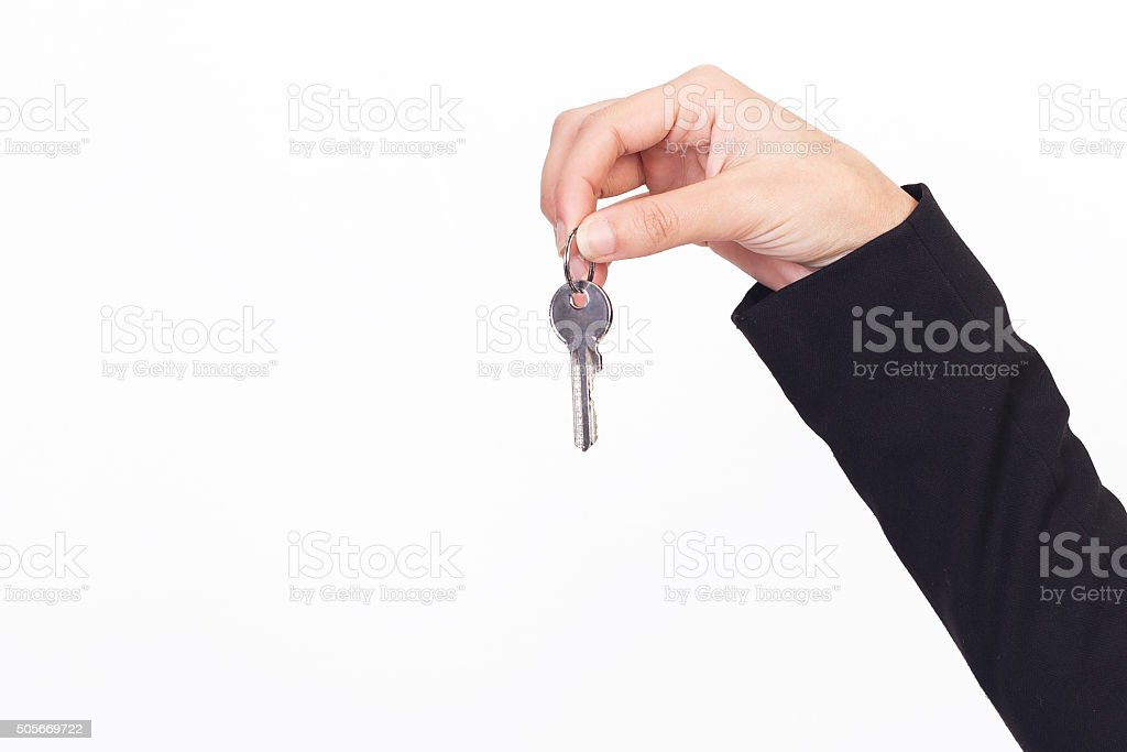 holding house key stock photo