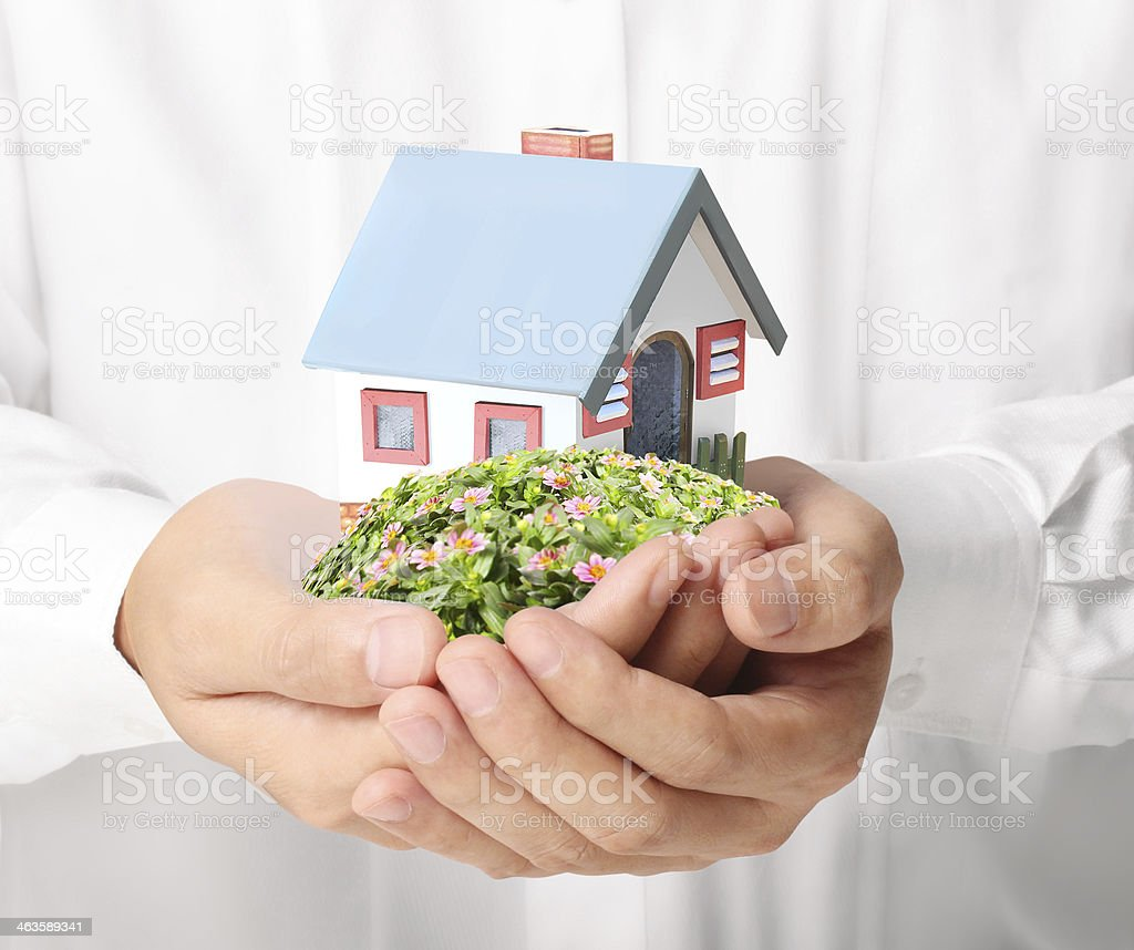 holding house representing home stock photo