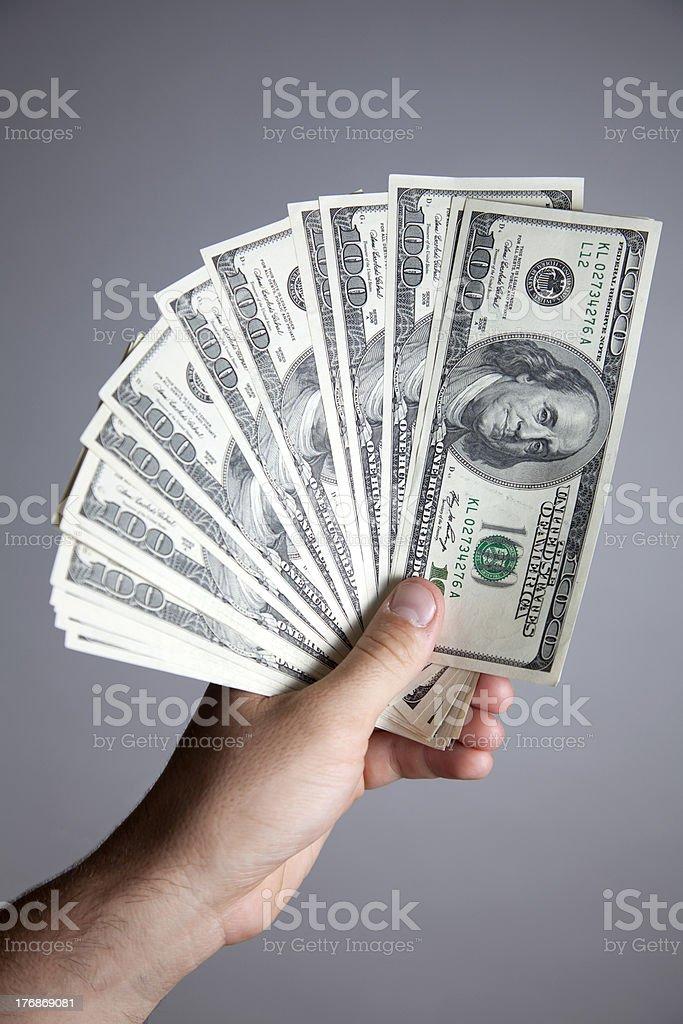 Holding Hundreds royalty-free stock photo