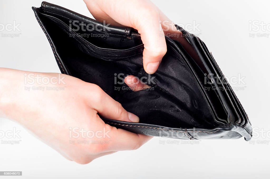 Holding in hands empty black wallet on white background stock photo