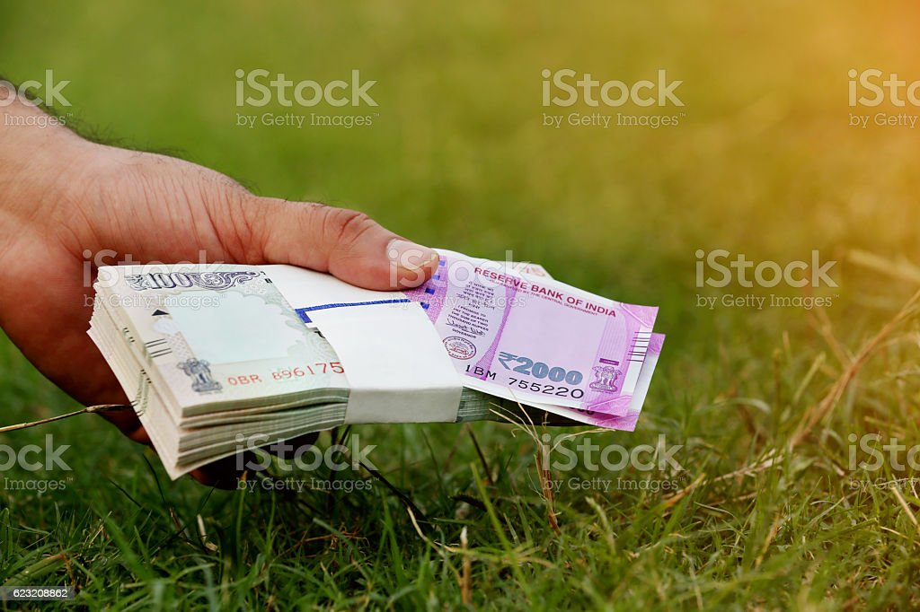 Holding Indian Currency stock photo