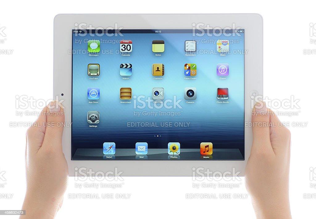 Holding iPad 3 royalty-free stock photo