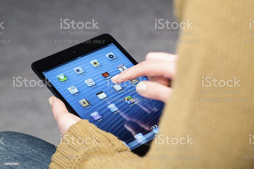 Holding iPad Mini royalty-free stock photo