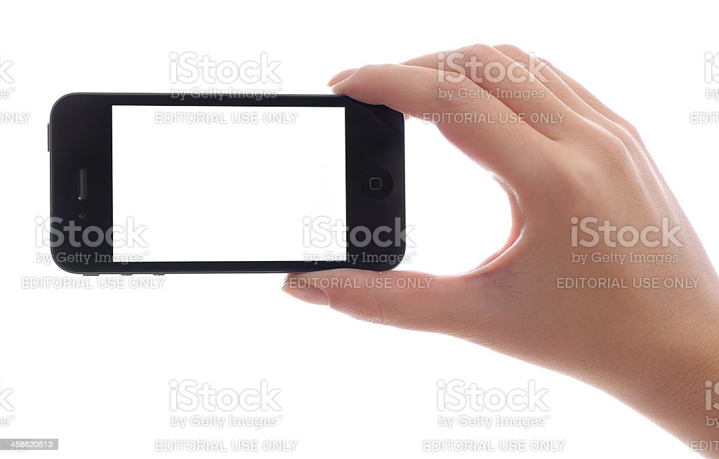 Holding iPhone 4 with blank screen stock photo