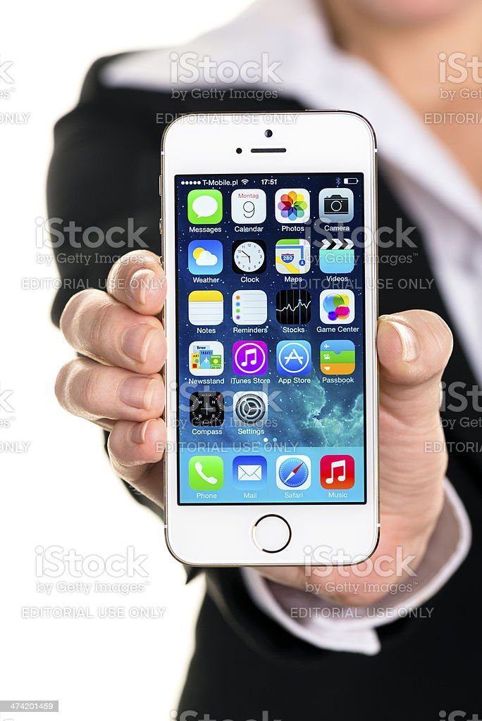 Holding iPhone 5S royalty-free stock photo