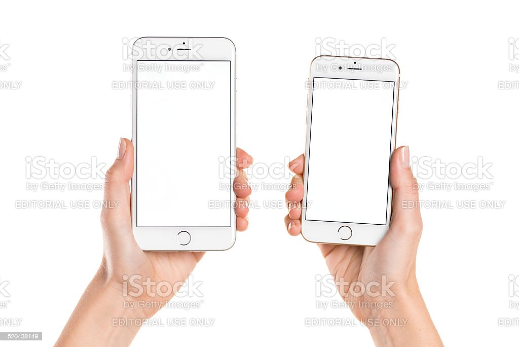 Holding iPhone 6 and iPhone 6 Plus with white screen stock photo