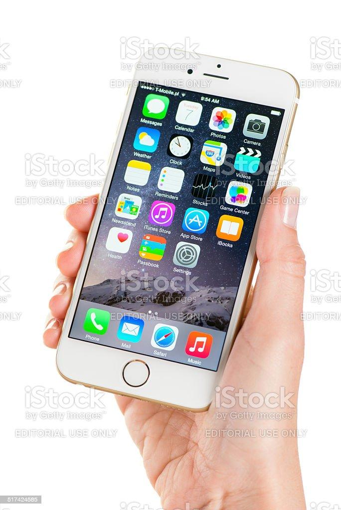 Holding iPhone 6 stock photo