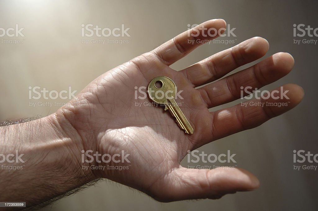 holding key royalty-free stock photo