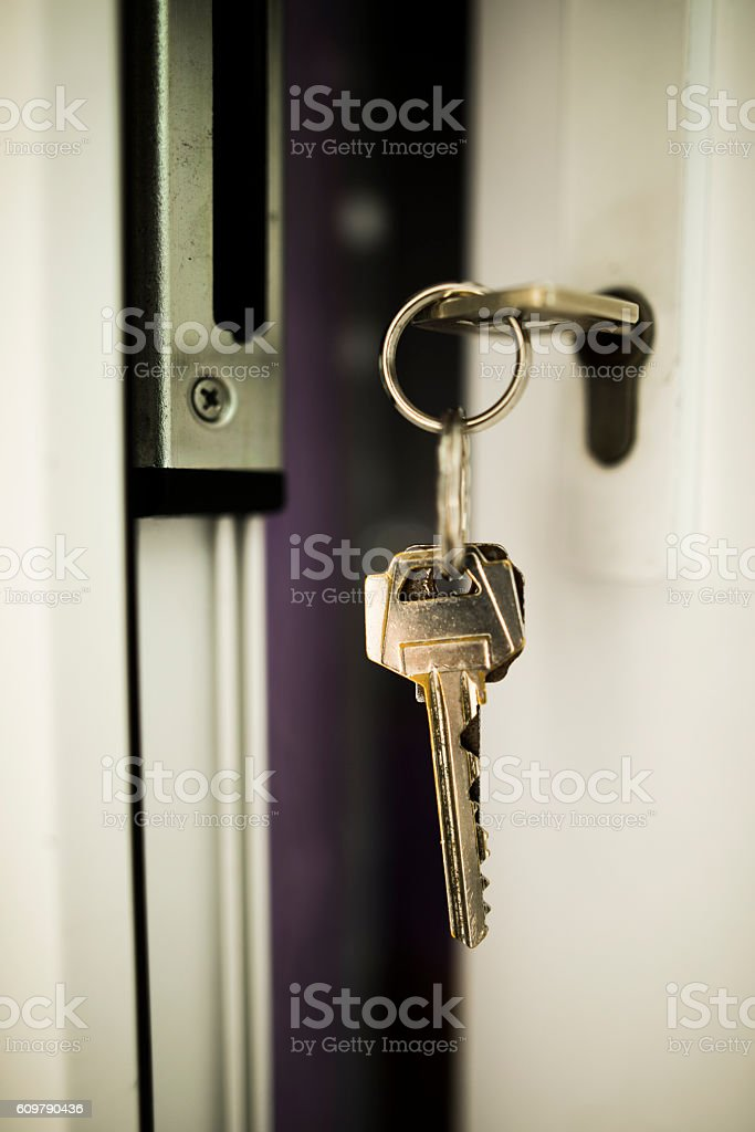 Holding keys stock photo
