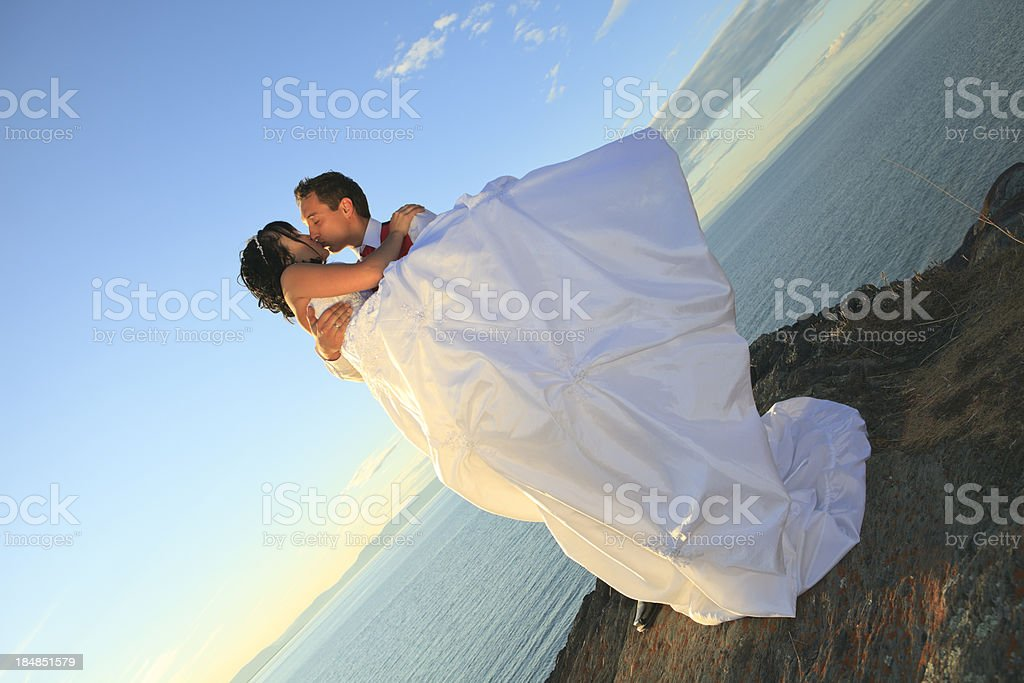 Holding Kiss Wedding Couple Horizontal royalty-free stock photo