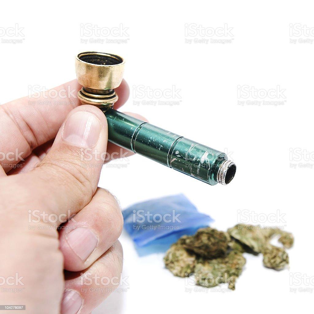 Holding Marijuana PIpe royalty-free stock photo