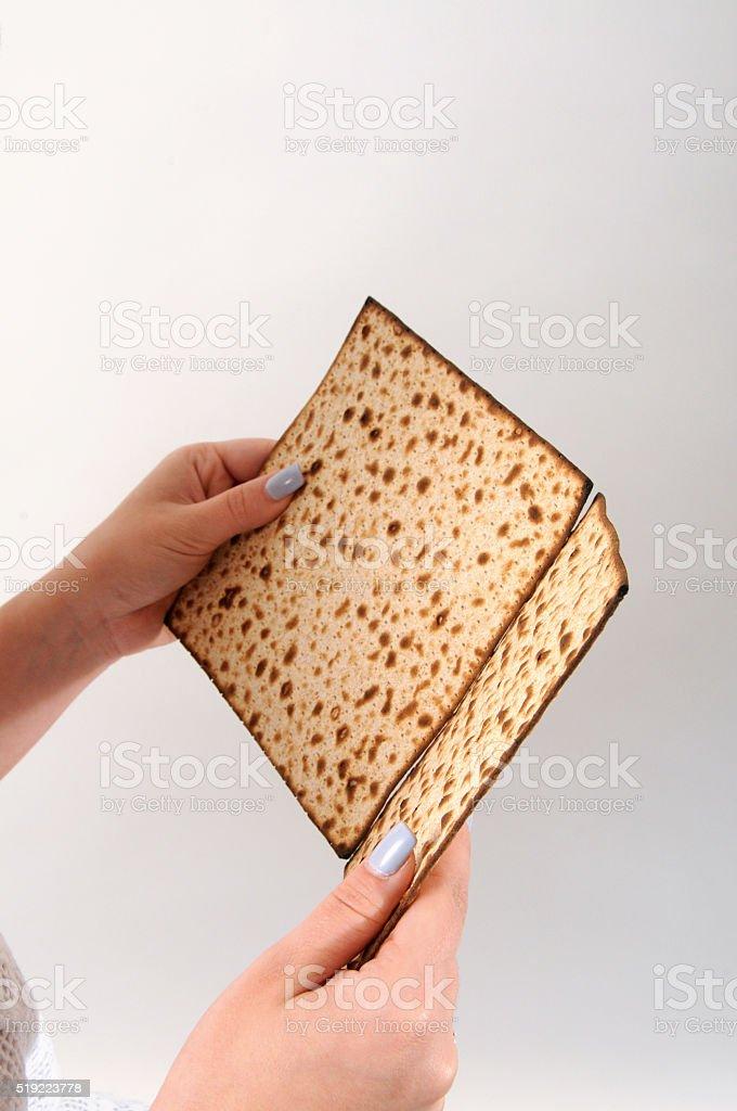 Holding Matzo, as a reading hahadah book stock photo