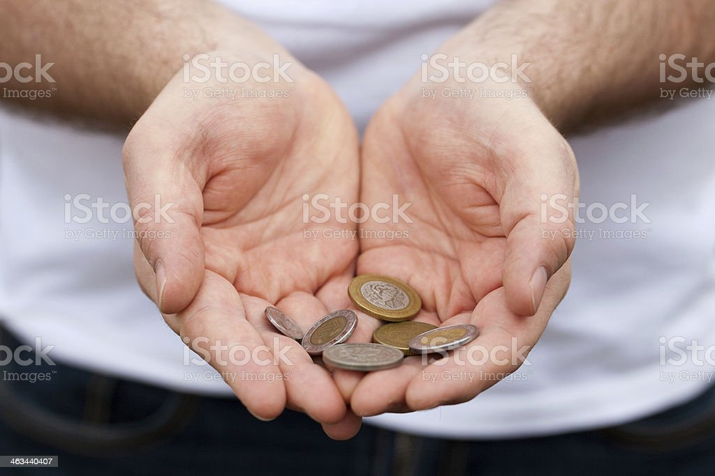 Holding Mexican Coins stock photo