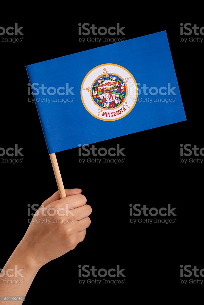 Holding Minnesota flag stock photo