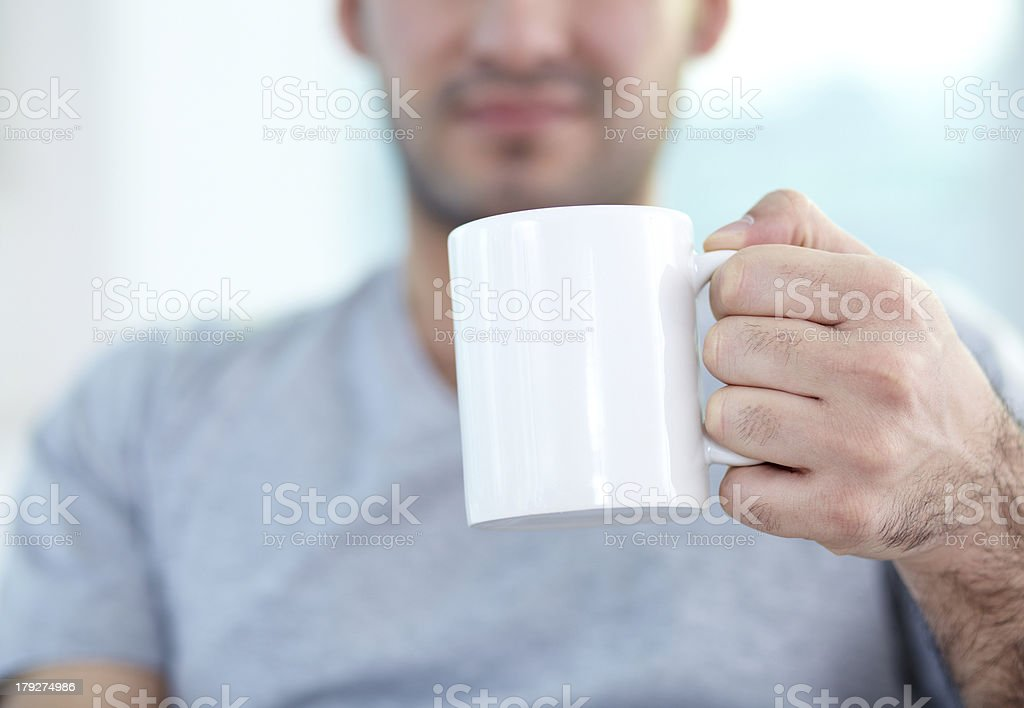 Holding mug stock photo