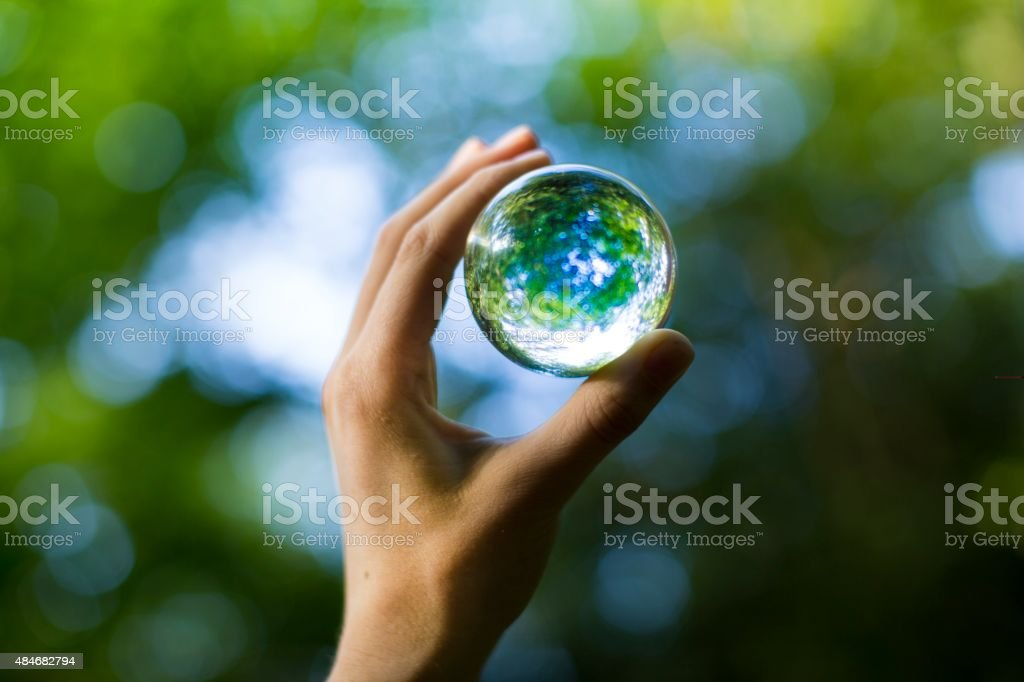 holding nature orb stock photo