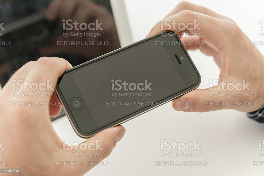 holding new Apple Iphone 5 royalty-free stock photo