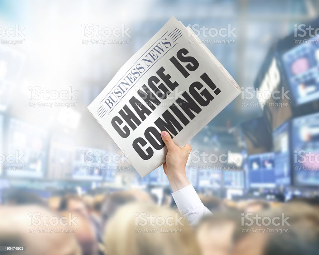 Holding Newspaper Change is coming stock photo
