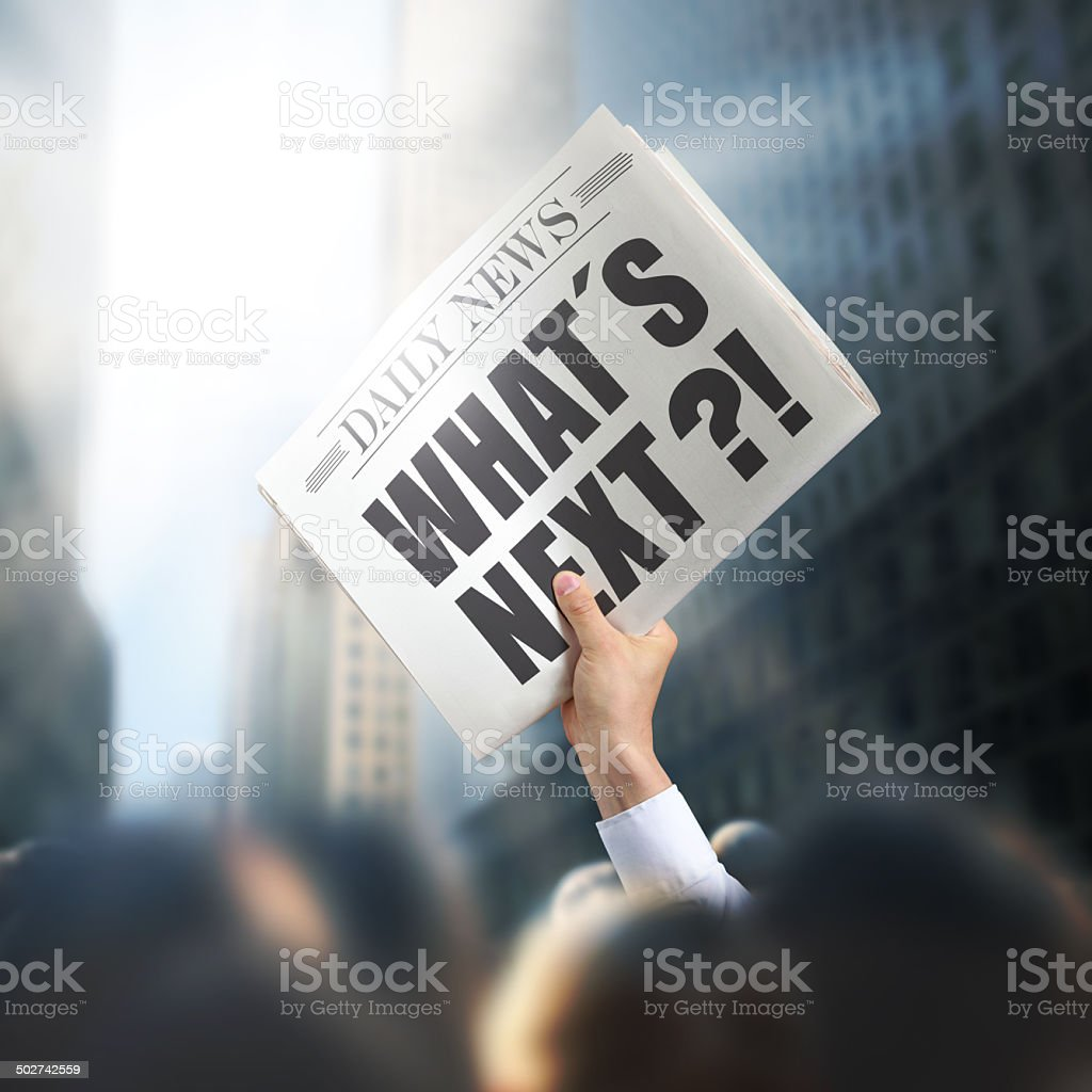 Holding Newspaper with Whats Next stock photo