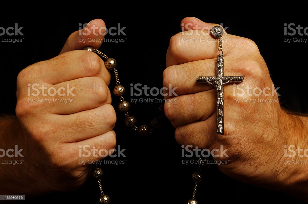 Holding on to your faith stock photo