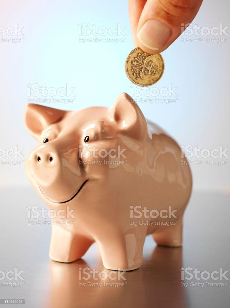Holding One British Pound royalty-free stock photo