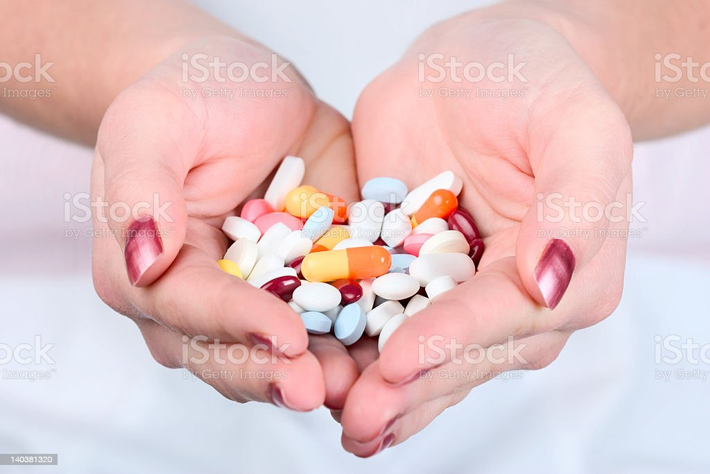 Holding out pills royalty-free stock photo