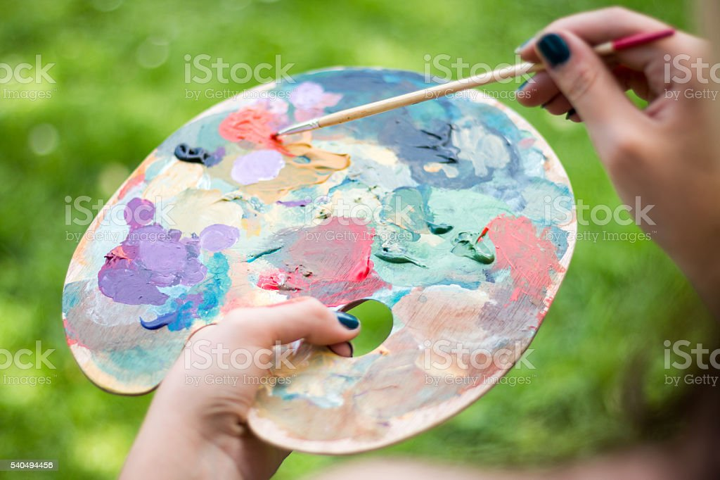 Holding Palette stock photo