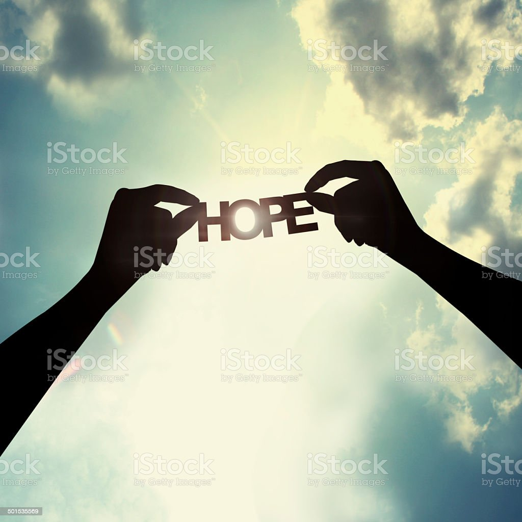 Holding paper cut of hope stock photo