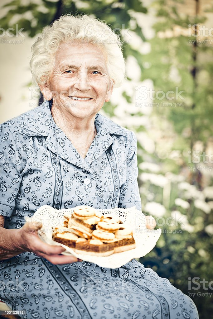 Holding pastry stock photo