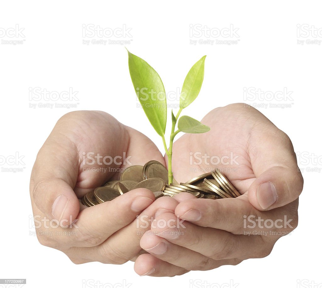 holding plant sprouting from a handful of coins royalty-free stock photo