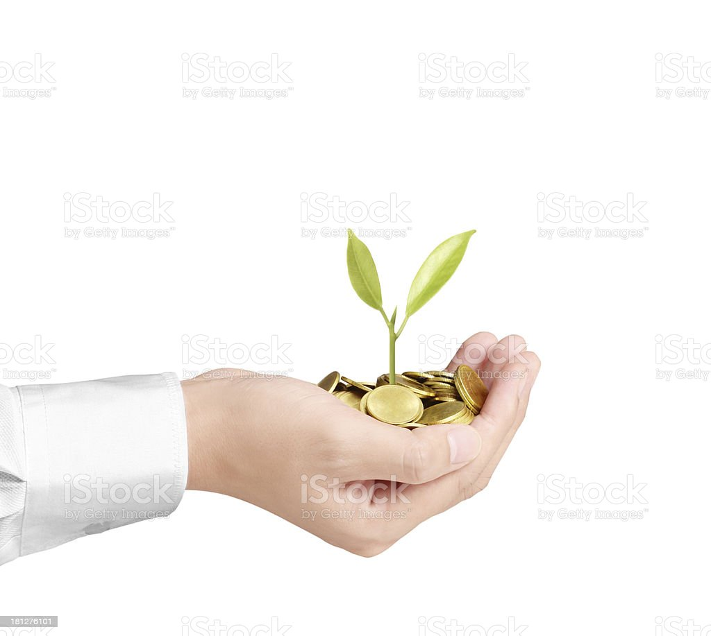 holding plant sprouting from  handful of coins royalty-free stock photo