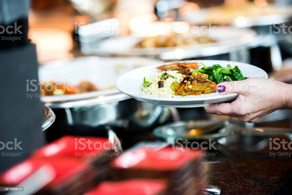 Holding plate with food stock photo