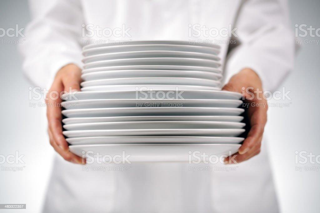 Holding plates stock photo