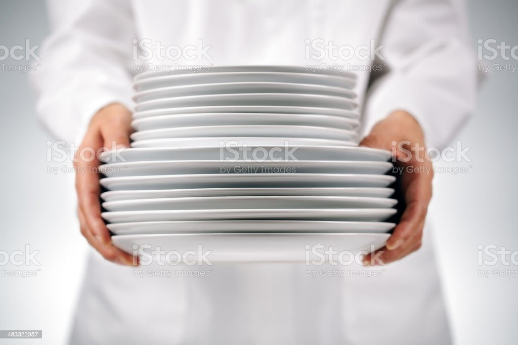 Holding plates stock photo