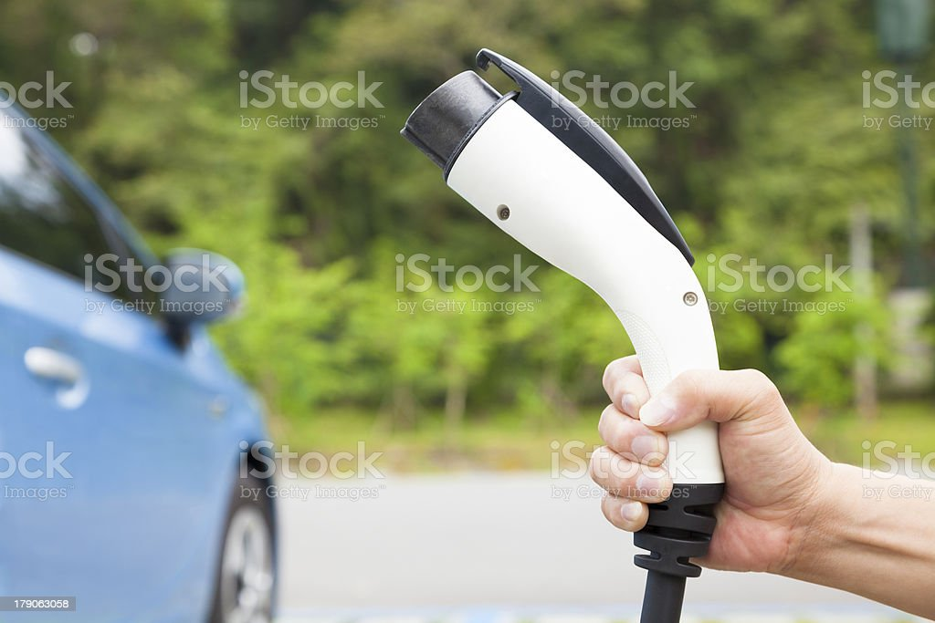 holding plug  connector for Charging electric car royalty-free stock photo