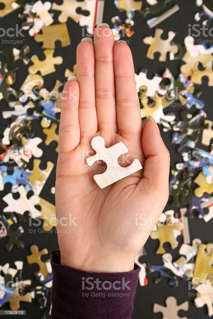 Holding puzzle piece royalty-free stock photo
