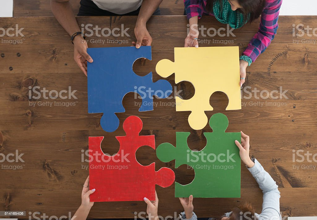 Holding Puzzle Pieces stock photo
